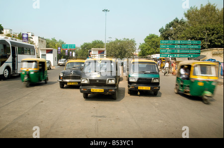 Taxis of different types in New Delhi, India - Stock Photo