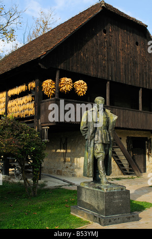 Ethnological Folk Museum Staro Selo in Kumrovec with the statue of Marshal Josip Broz Tito - Stock Photo