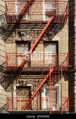 A neighborhood brick apartment with New York character as viewed from the street. - Stock Photo
