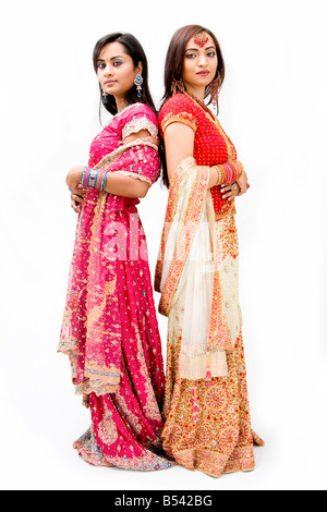 Two beautiful Bangali brides in colorful dresses isolated - Stock Photo