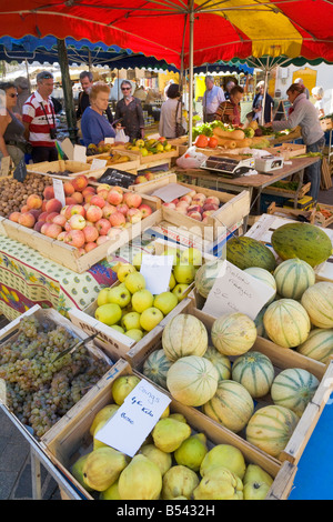 Shopping on a provencal farmers market in Sainte-Maxime at the Cote d'Azur / Provence - Stock Photo