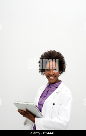 african american woman doctor nurse medical chart - Stock Photo