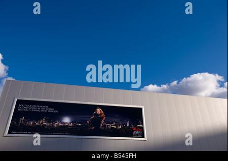 Billboard advertising newly built luxury Westfield Shopping Centre White City W12 London United Kingdom - Stock Photo