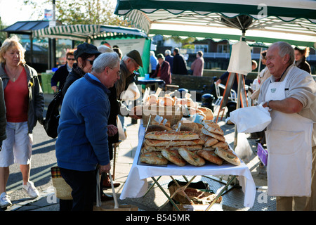 united kingdom west sussex arundel a bakers stall in the monthly farmers market - Stock Photo