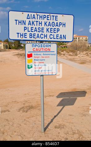 Bilingual PLEASE KEEP THE BEACH CLEAN sign on beach near Ayia Napa on the Mediterranean island of Cyprus EU - Stock Photo