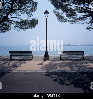 Benches with view to the Lake Garda, Toscolano-Maderno, Italy - Stock Photo