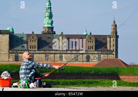 Sea angler in front of Kronborg Slot Elsinore Castle Helsingør Denmark setting for Shakespeares Hamlet - Stock Photo