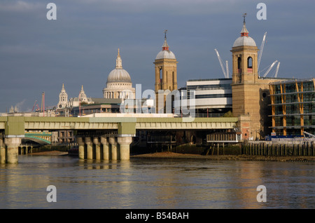 City Spires: Spires of St Paul's Cathedral and Cannon Street Station and Railway Bridge above River Thames, City - Stock Photo