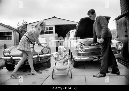 Models pose for a Lolly Dolly wives feature in Manchester. Man and woman and child in a suburban neighbourhood. - Stock Photo