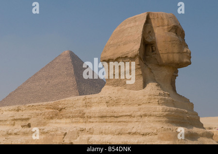 The Great Sphinx of Giza cut from the bedrock, with the Pyramid of Khafre in the background, Cairo Egypt - Stock Photo