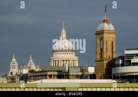 Spires of St Paul's Cathedral and Cannon Street Station above Cannon Street Railway Bridge, City of London, England - Stock Photo