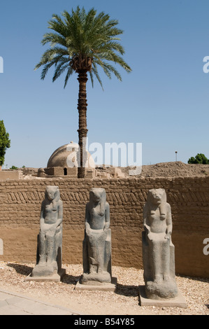 Ancient Pharaonic statues displayed at the Open Air Museum located in the northwestern corner of the Precinct of - Stock Photo