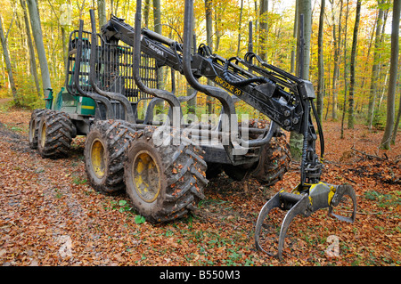 Timberjack forestry machine standing in the forest - Stock Photo