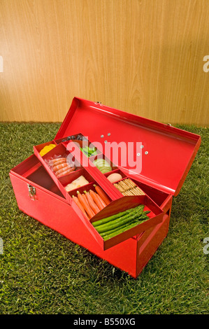 red tool box with food in top tray - Stock Photo