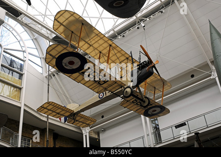 A First World War aeroplane hanging from the ceiling inside the Imperial War Museum London - Stock Photo