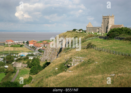 Old Church of St Nicholas at Uphill near Weston super Mare Somerset with the Severn estaury beyond - Stock Photo