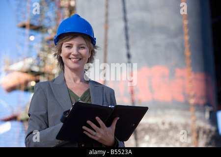A woman construction engineer on survey in a harbor - Stock Photo