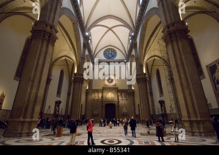 An interior view of the Basilica di Santa Maria del Fiore (Duomo) in Florence with tourists visiting and taking - Stock Photo