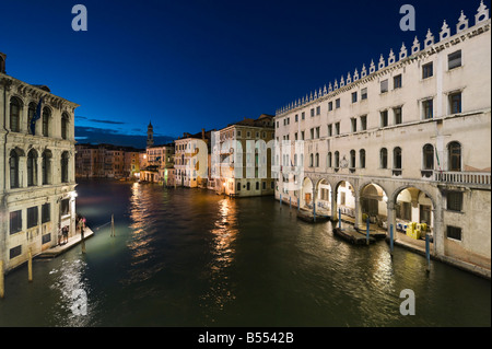 View of the Grand Canal from the Rialto Bridge at night with the main Post Office to the right ,Venice, Veneto, - Stock Photo