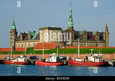Fishing boats in front of Kronborg Slot Elsinore Castle Helsingør Denmark - Stock Photo