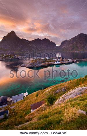 Lofoten Islands, with the hamlet of Sakrisøy, near Reine, in the foreground, Norway. - Stock Photo