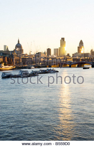 The River Thames and the city skyline at sunrise, London, UK. - Stock Photo
