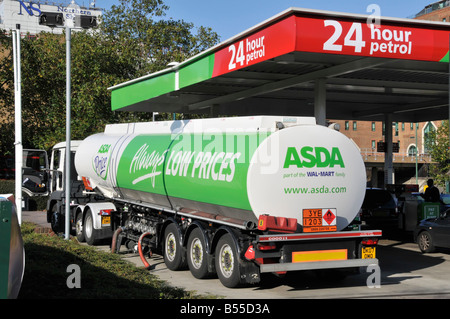 Asda supermarket  24 hour petrol filling station hgv lorry truck & articulated delivery tanker trailer unloading - Stock Photo