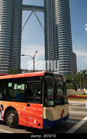 Rapid KL Bus at the Petronas Towers, Kuala Lumpur, Malaysia - Stock Photo