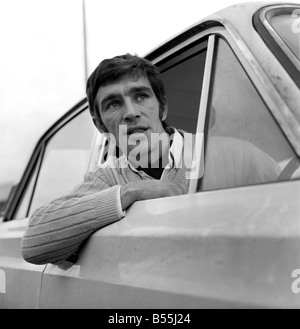 Motor: Cars. 31 year old Bryan Nash of Nunhead, S.E.15 with his 1966 MK1 Ford Cortina. December 1969 Z12139-001 - Stock Photo