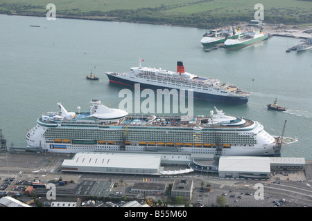 Queen Elisabeth 2 (QE2) passes Independence of the Seas on it's way out of Southampton Docks. - Stock Photo