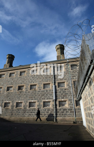 Prison Officer walking outside Craiginches prison in Aberdeen city, Scotland, UK - Stock Photo