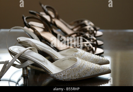 Bride and Bridesmaids shoes in a row - Stock Photo