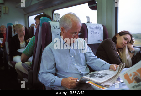 Passengers on a first great western train in england - Stock Photo