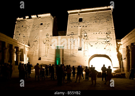 Tourists at Isis Temple in Philae temple complex on Agilkia island in the reservoir of the Aswan Low Dam Egypt - Stock Photo