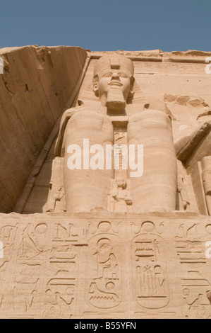 The colossal statue of Pharaoh decorating entrance to the Sun Temple Of Ramses II in Abu Simbel rock temples. Southern - Stock Photo