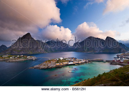Clouds gather over the peaks above Sakrisøy, near Reine, Lofoten Islands, Norway. - Stock Photo