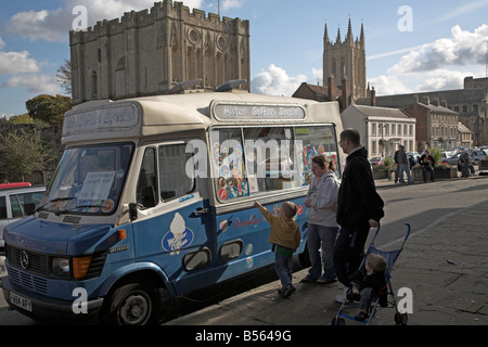 Family buying ice creams from van with Abbey gate and cathedral behind Bury St Edmunds Suffolk England - Stock Photo