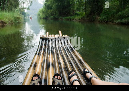 People taking a bamboo boat ride on the Yu Long or Dragon River, Yangshuo, China - Stock Photo