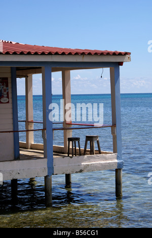 Two stools on the deck of Anastasia's restaurant and Bar on Big Corn Island, Nicaragua, Central America - Stock Photo