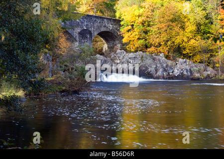 autumn colour at the Bridge of Balgie in Glen Lyon Scotland - Stock Photo