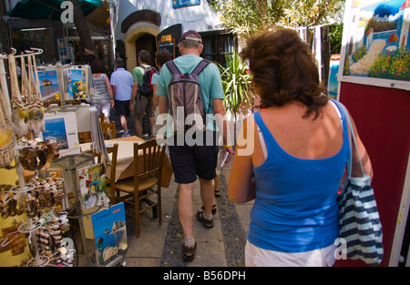 Tourists browsing stalls on shopping street in the city of Southern Nicosia Cyprus EU - Stock Photo