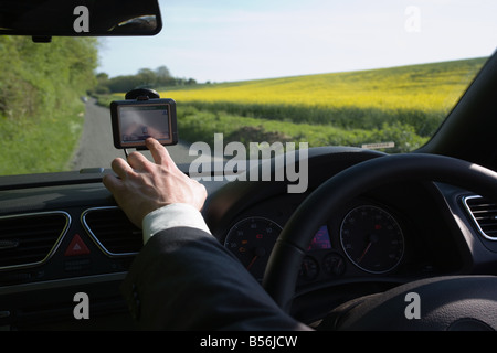 A man pointing to a gps - Stock Photo