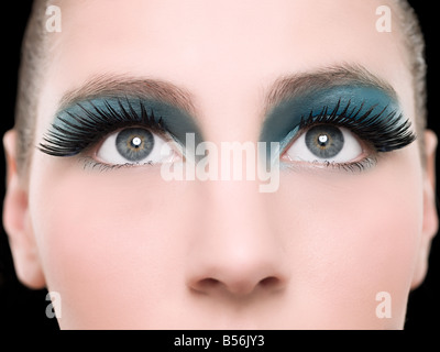 A young woman wearing false eyelashes - Stock Photo