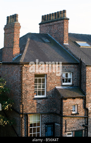 The rear of a brick terraced Victorian house in York - Stock Photo