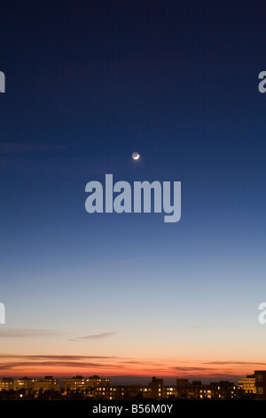 Moon in sky above hove - Stock Photo