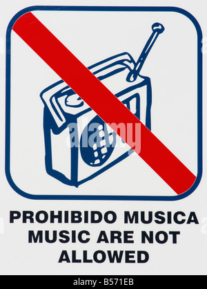 No music sign in English and Spanish - Stock Photo