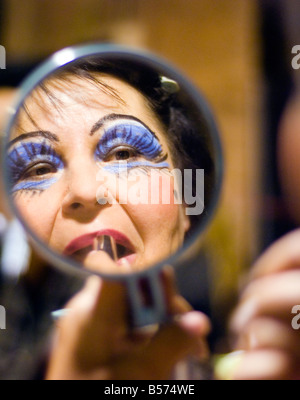 Member of the Ballet of the Theatre Usti nad Labem puts on makeup for a production of Carmina Burana Monumental - Stock Photo