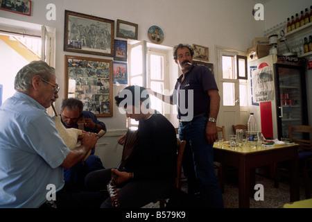 greece, dodecanese islands, karpathos, olymbos, kafenion, greek men playing traditional music - Stock Photo