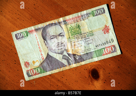 Kenya 100 shilling currency bills on table - Stock Photo