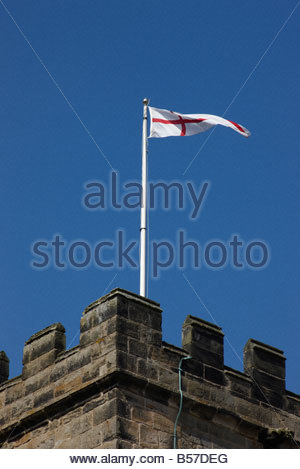 The English flag of St George on flagpole on tower of St Michael with St Mary Melbourne Derbyshire England - Stock Photo
